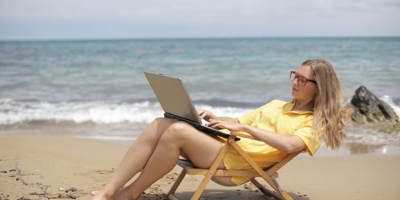 one of the most popular reasons to work from anywhere - laptop at the beach